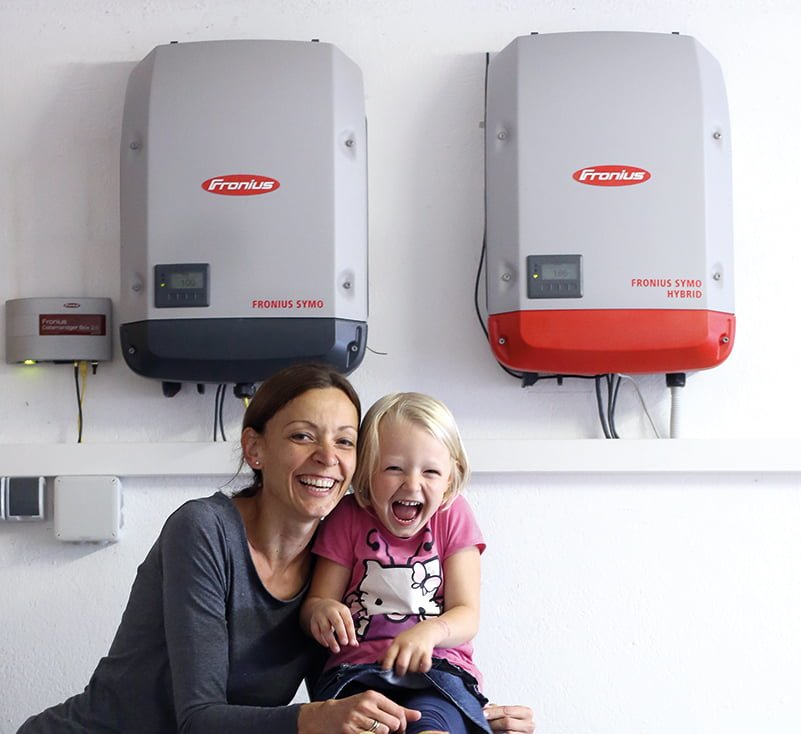 Smiling Family with Solar Inverters